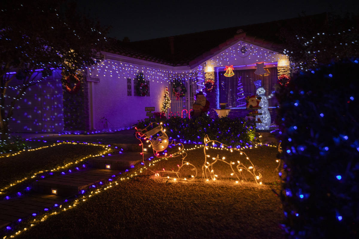 A Henderson resident's home in the Green Valley South neighborhood off Pecos Road is decorated ...