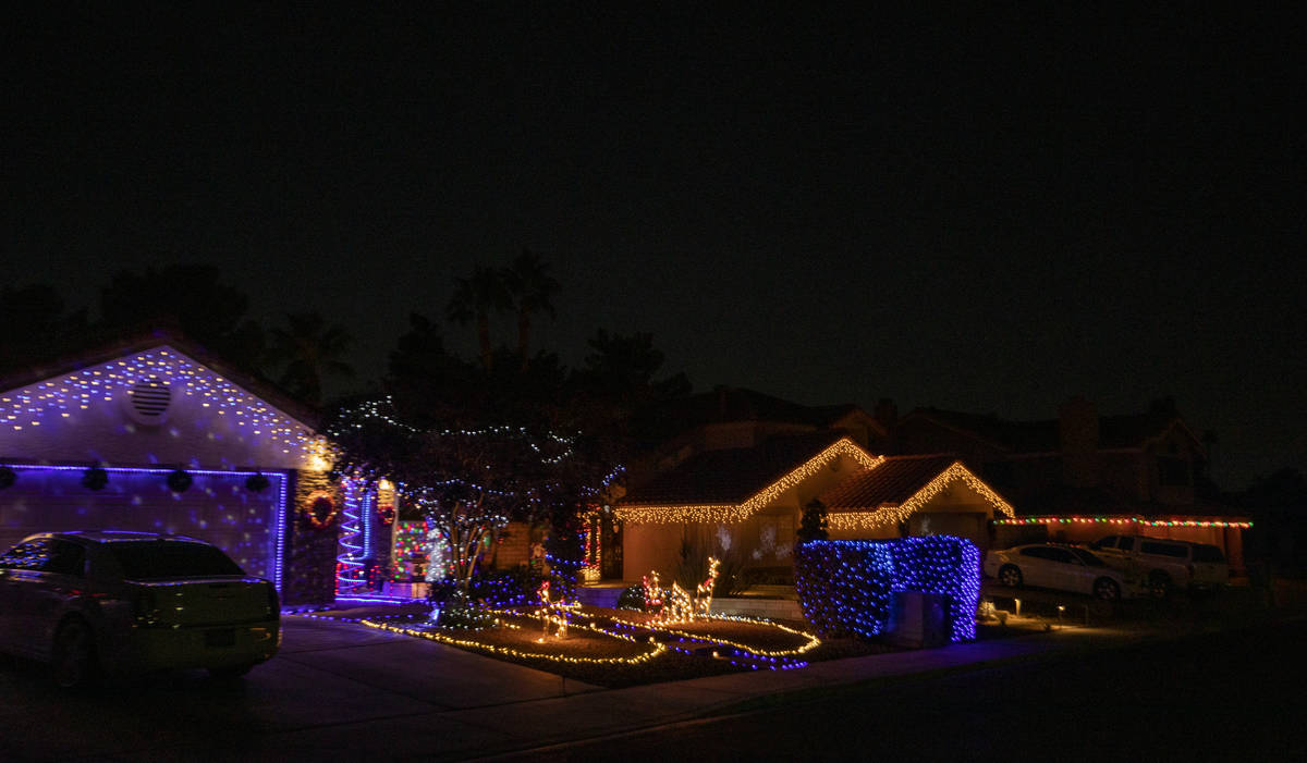 Holiday lights in the Green Valley South neighborhood off Pecos Road in Henderson are decorated ...