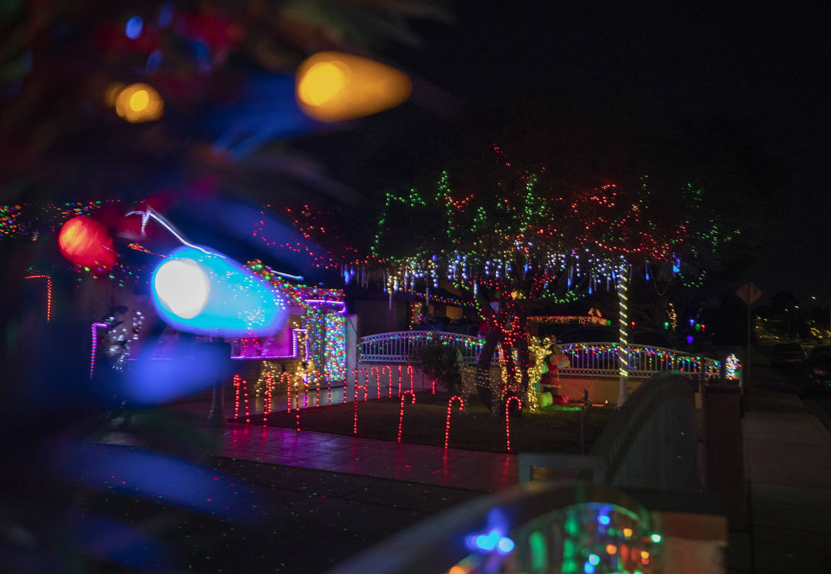 A house on East Oakey Boulevard is decorated for the season, Thursday, Dec. 3, 2020. (Elizabeth ...