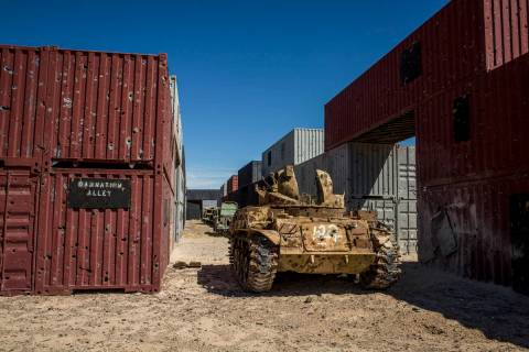 """An armored vehicle riddled with bullet holes waits in """"Damnation Alley,"""" where aircraft and gro ..."""