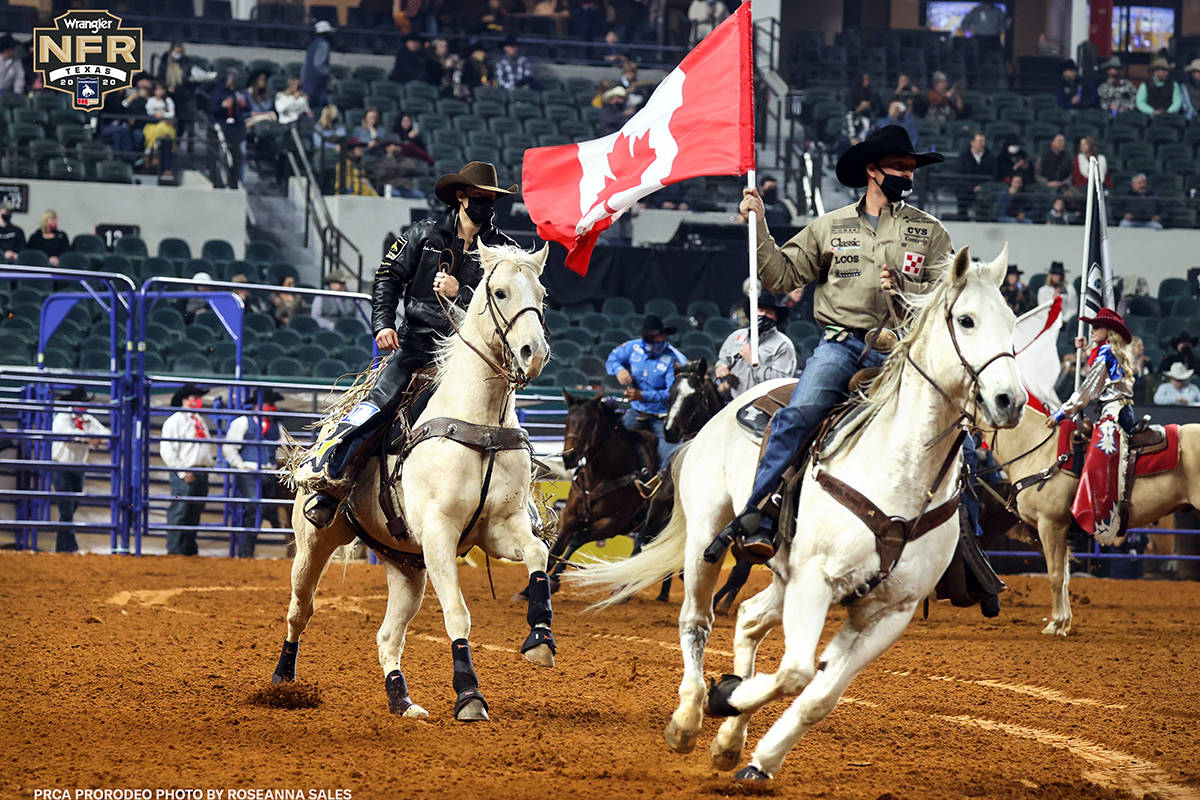 The grand entry on Day 2 of the Wrangler National Finals Rodeo at Globe Life Field in Arlington ...