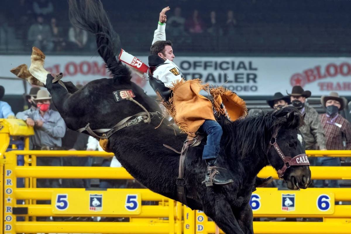 Kaycee Feild performs during the 3rd go-round of the National Finals Rodeo in Arlington, Texas, ...