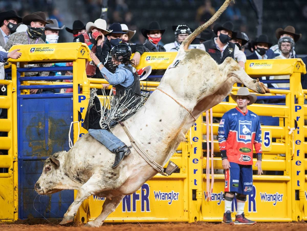 Colten Fritzlan rides during the 3rd go-round of the National Finals Rodeo in Arlington, Texas, ...