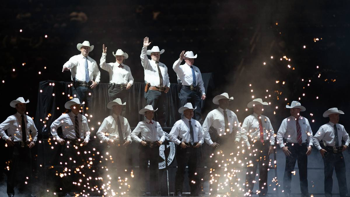 The Grand Entry performance lights up the 3rd go-round of the National Finals Rodeo in Arlingto ...