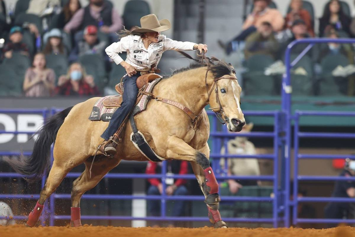 Lisa Lockhart performs during the 3rd go-round of the National Finals Rodeo in Arlington, Texas ...