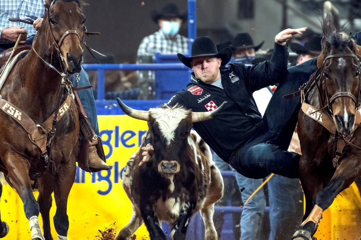 Will Lummus performs during the 3rd go-round of the National Finals Rodeo in Arlington, Texas, ...