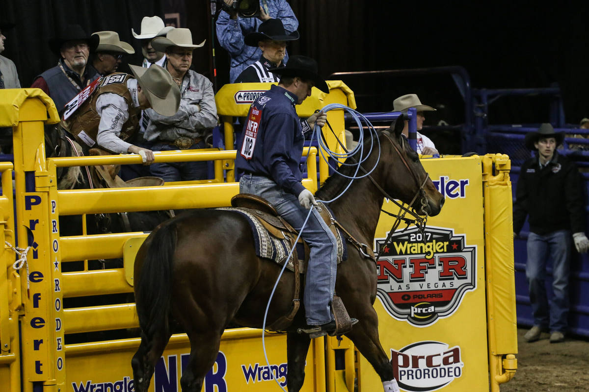 Charly Crawford of Prineville, Ore. rides away after the team roping event during the third nig ...