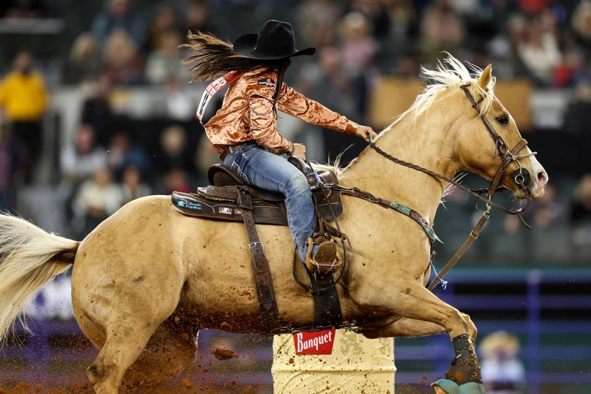 Hailey Kinsel rides during the 4th go-round of the National Finals Rodeo in Arlington, Texas, o ...
