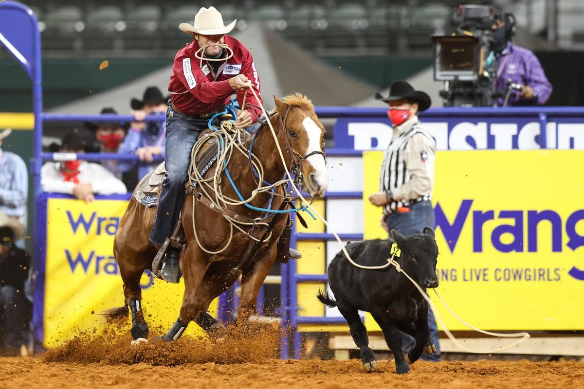 Adam Gray rides during the 4th go-round of the National Finals Rodeo in Arlington, Texas, on Su ...
