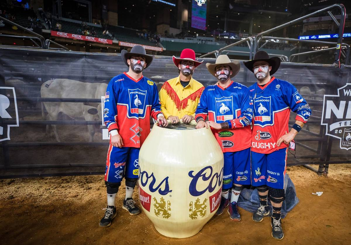 Clowns are seen during the 4th go-round of the National Finals Rodeo in Arlington, Texas, on Su ...