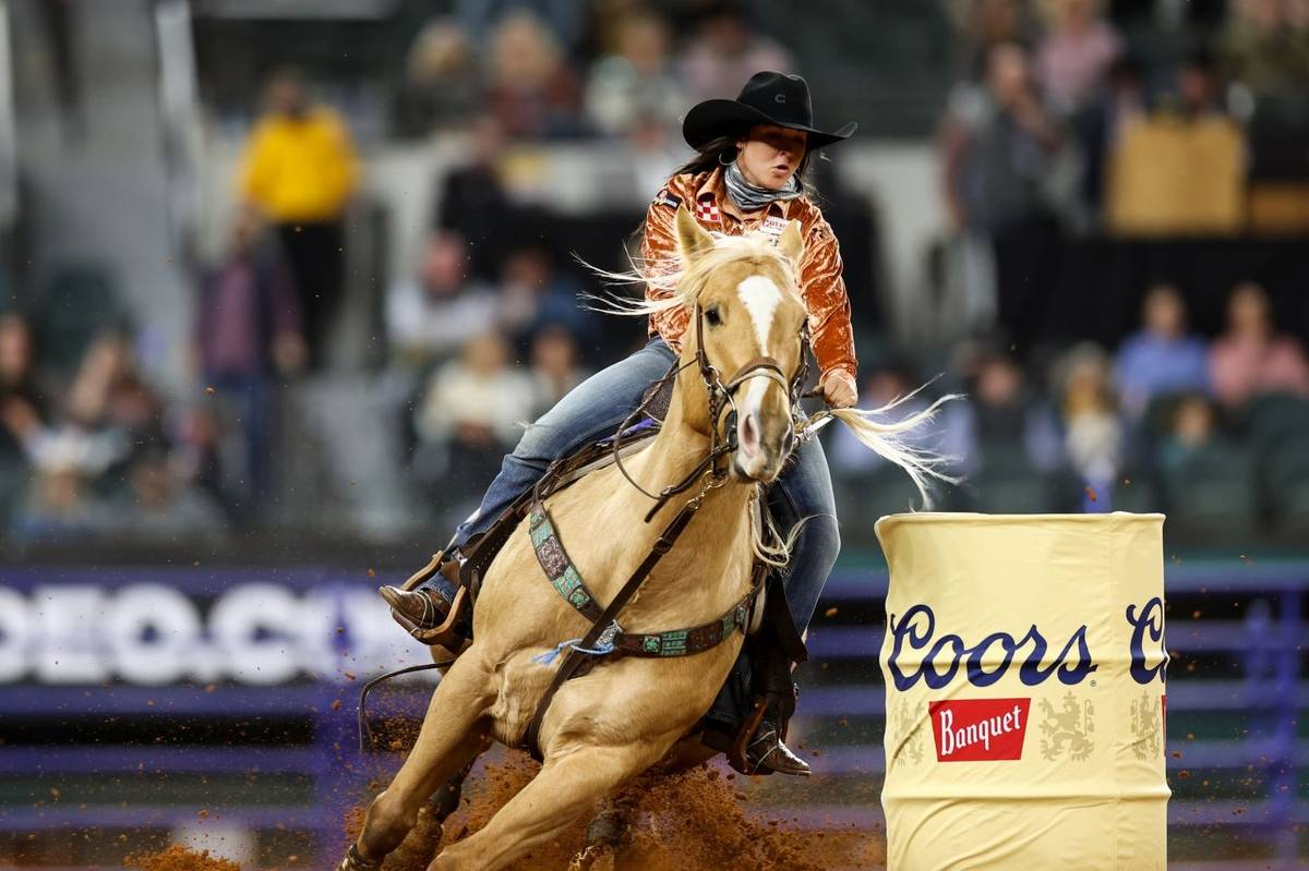 Hailey Kinsel performs during the 4th go-round of the National Finals Rodeo in Arlington, Texas ...
