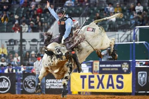 Ty Wallace performs during the 4th go-round of the National Finals Rodeo in Arlington, Texas, o ...