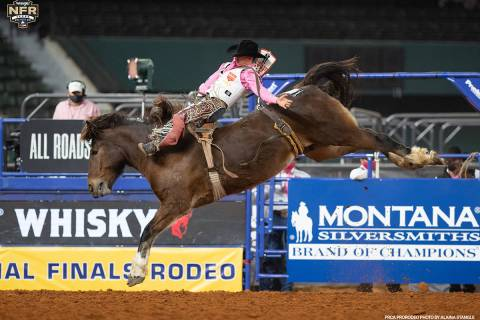 Clayton Biglow performs during the fifth go-round of the National Finals Rodeo in Arlington, Te ...