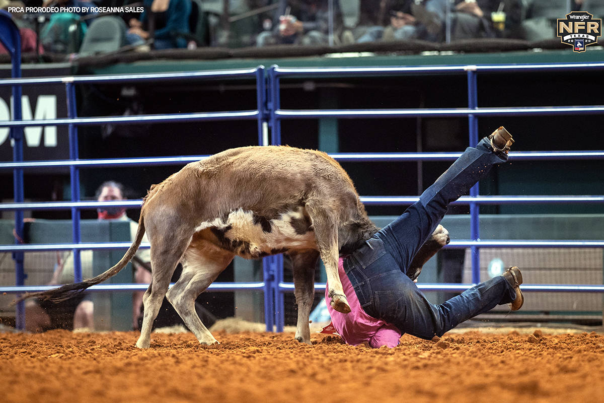 Jacob Talley performs during the fifth go-round of the National Finals Rodeo in Arlington, Texa ...