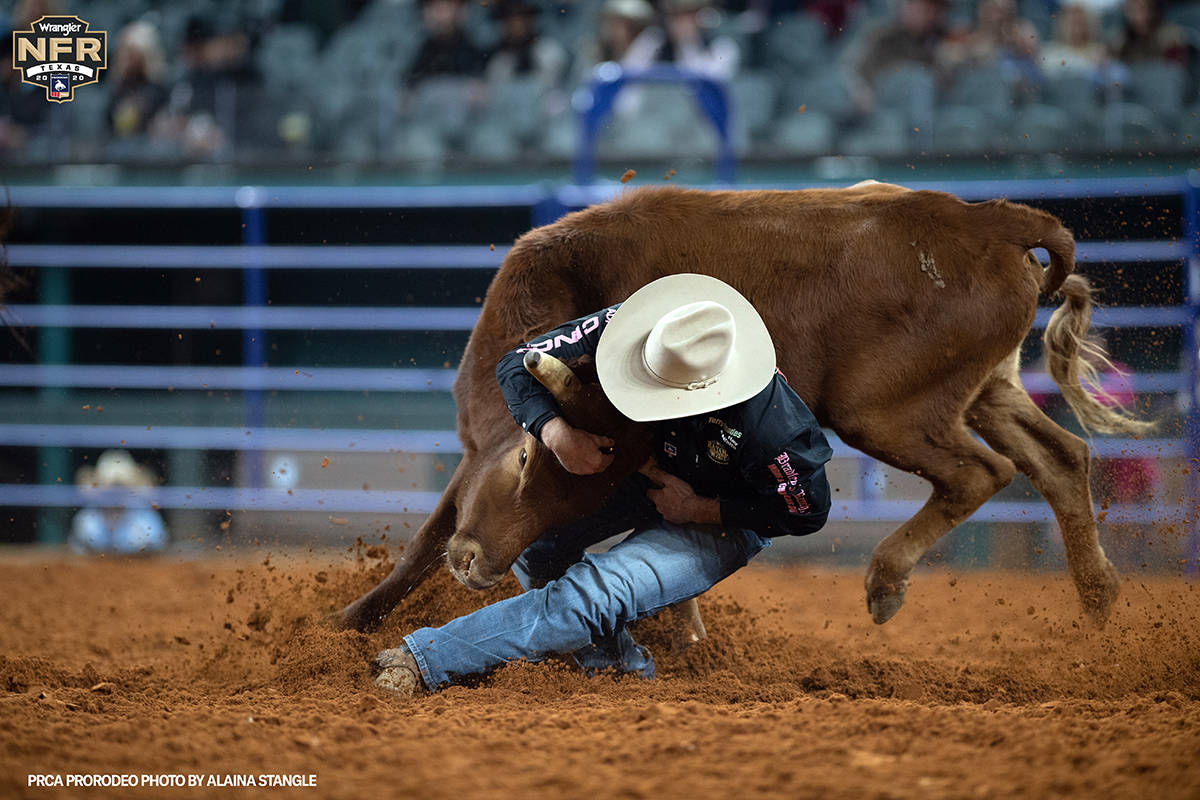 Matt Reeves performs during the fifth go-round of the National Finals Rodeo in Arlington, Texas ...