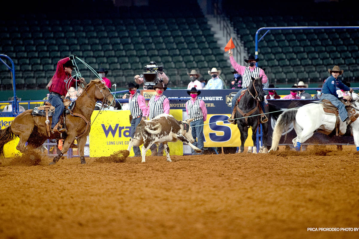 Clay Smith and Jade Corkill perform during the fifth go-round of the National Finals Rodeo in A ...