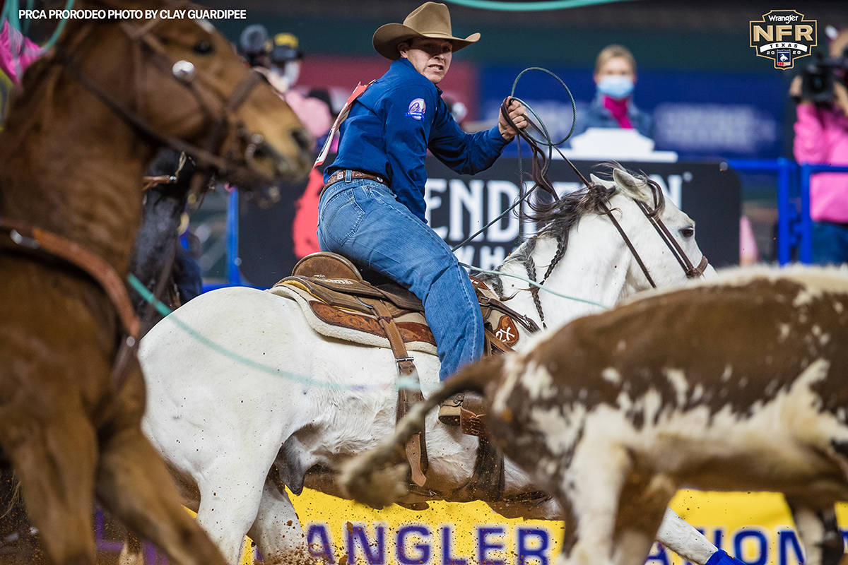 Clay Smith performs during the fifth go-round of the National Finals Rodeo in Arlington, Texas, ...