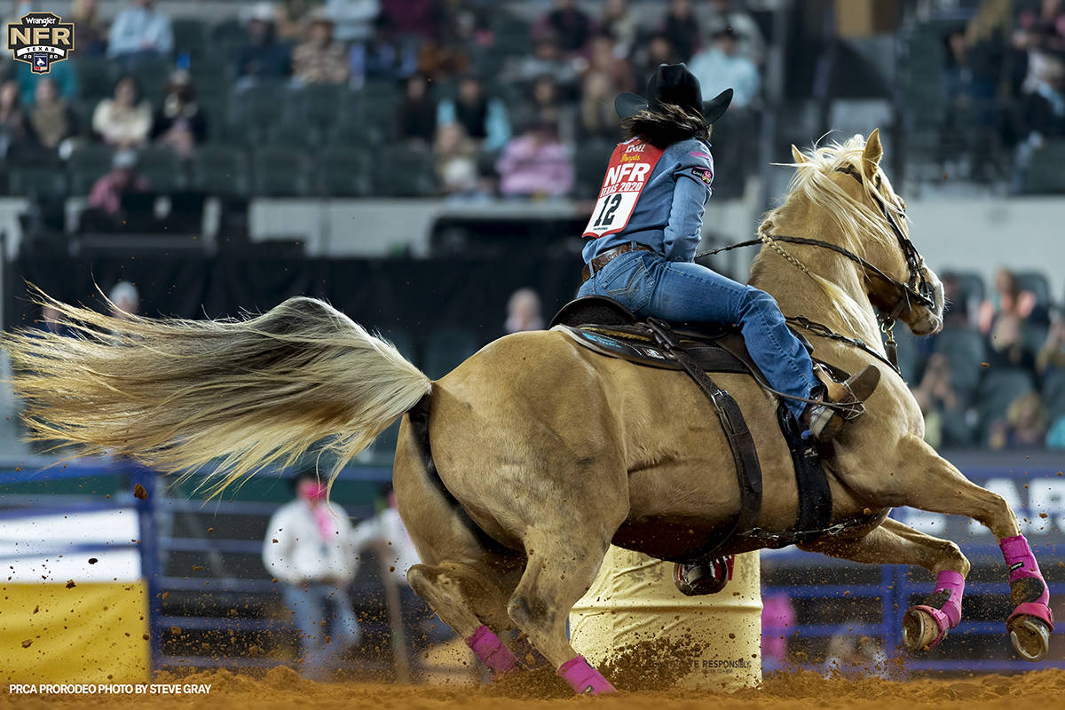 Hailey Kinsel performs during the fifth go-round of the National Finals Rodeo in Arlington, Tex ...