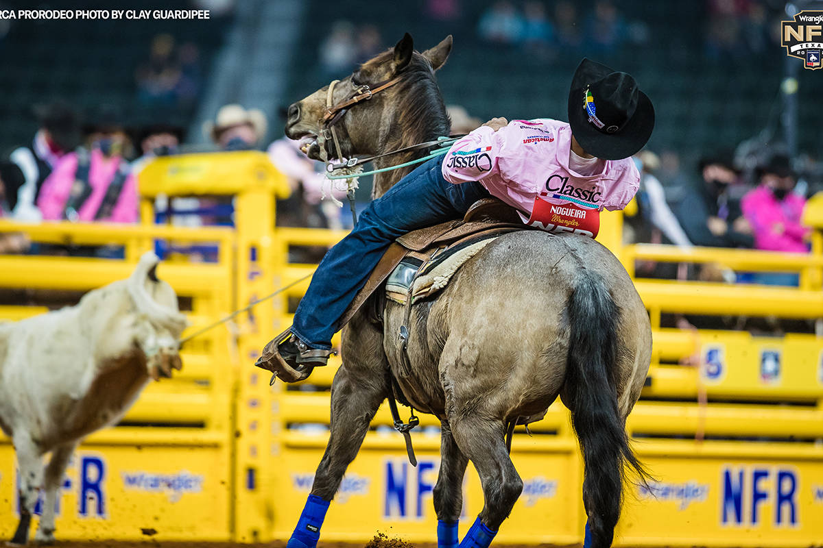 Junior Nogueira performs during the fifth go-round of the National Finals Rodeo in Arlington, T ...