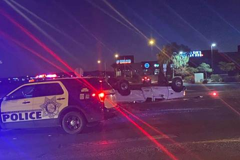 A white pickup was flipped in a collision at South Durango Drive and the 215 Beltway on Tuesday ...