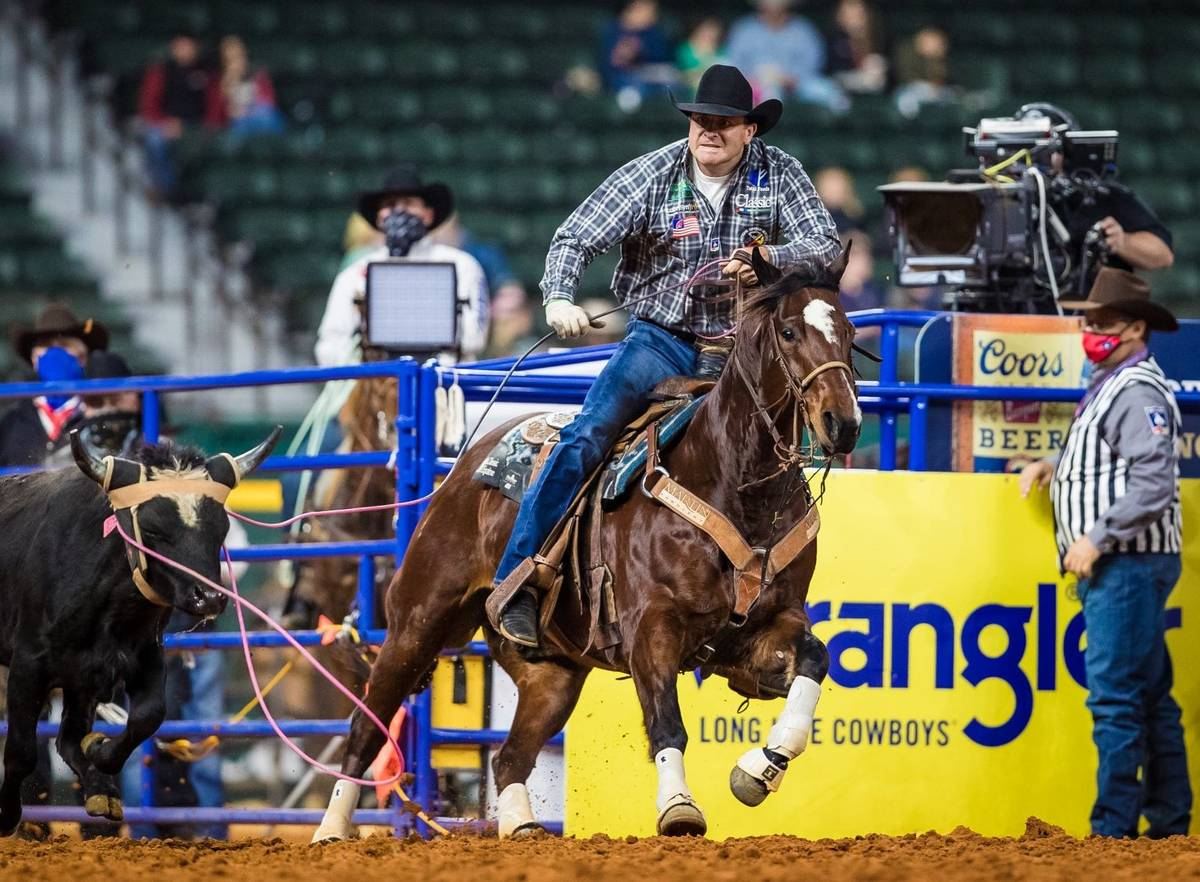 Charly Crawford performs during the 7th go-round of the National Finals Rodeo in Arlington, Tex ...