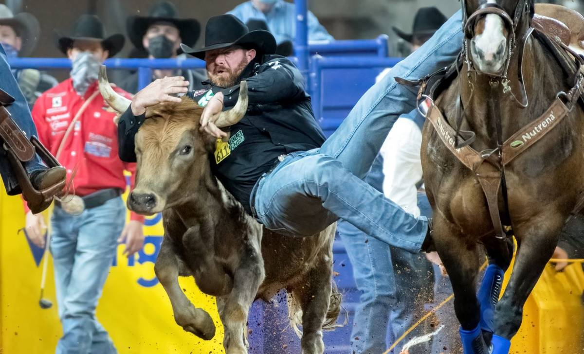 Clayton Hass performs during the 7th go-round of the National Finals Rodeo in Arlington, Texas, ...