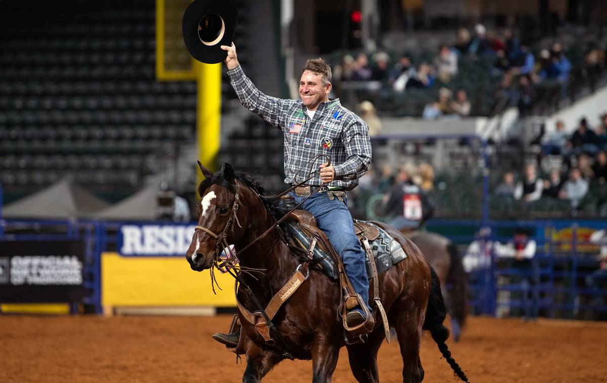 Logan Medlin performs during the 7th go-round of the National Finals Rodeo in Arlington, Texas, ...