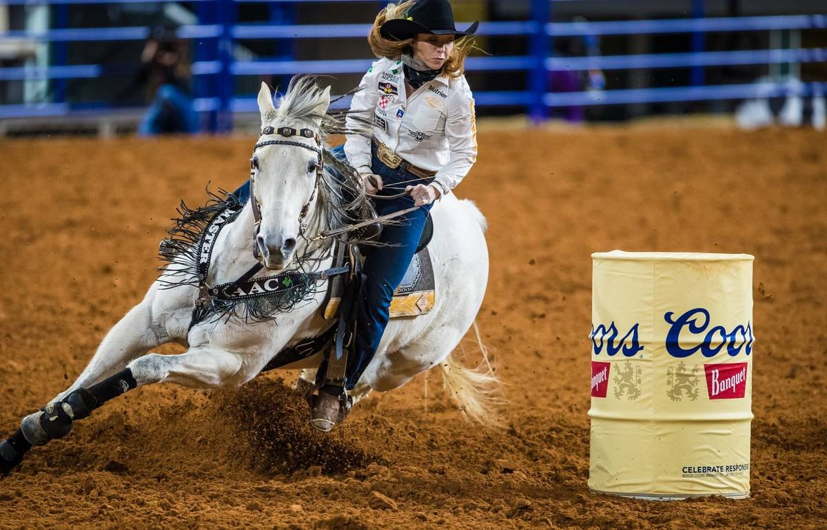 Emily Miller performs during the 7th go-round of the National Finals Rodeo in Arlington, Texas, ...