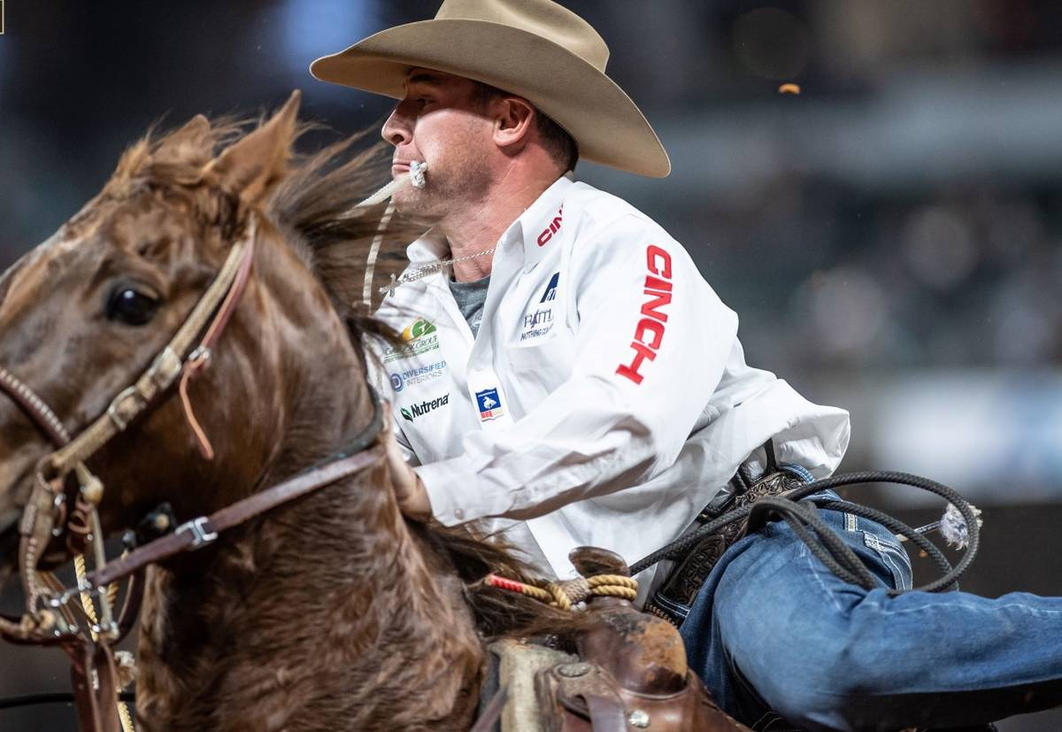 Hunter Herrin rides during the 7th go-round of the National Finals Rodeo in Arlington, Texas, o ...