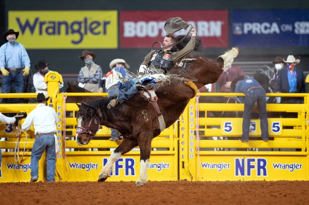 Orin Larsen rides during the 7th go-round of the National Finals Rodeo in Arlington, Texas, on ...