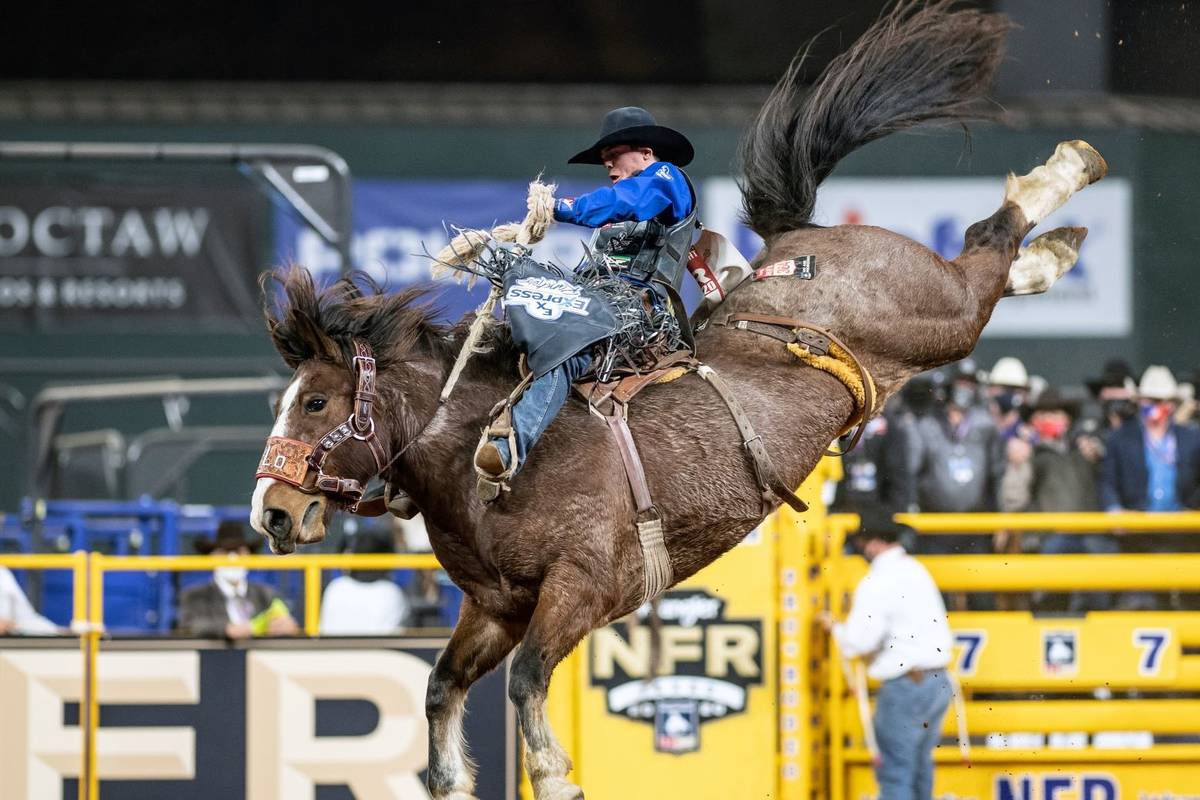 Stetson Wright rides during the 7th go-round of the National Finals Rodeo in Arlington, Texas, ...