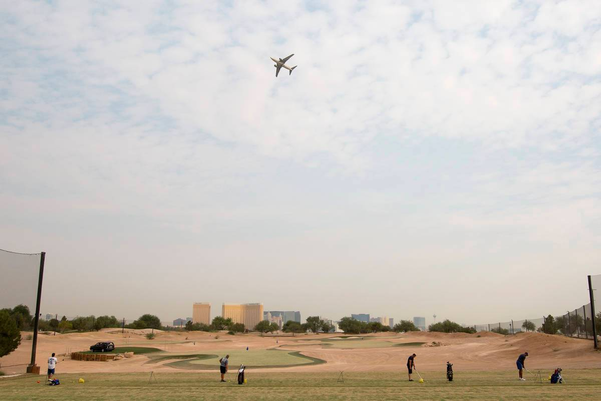 An airplane flies over Las Vegas Golf Center on Friday, Sept. 18, 2020, in Las Vegas. (Ellen Sc ...