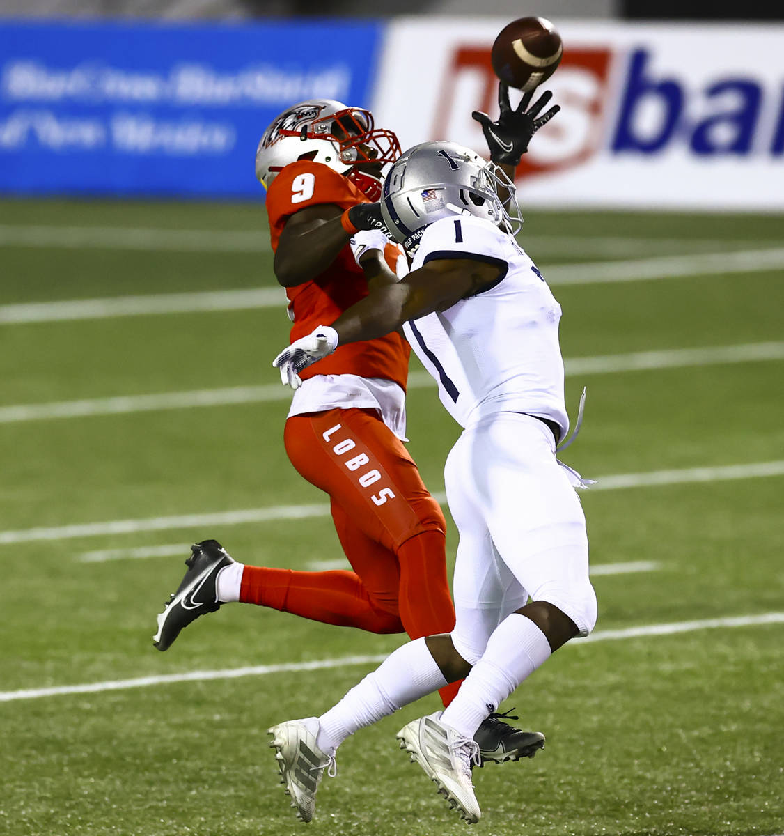 New Mexico Lobos safety Jerrick Reed II (9) intercepts a pass intended for UNR Wolf Pack wide r ...