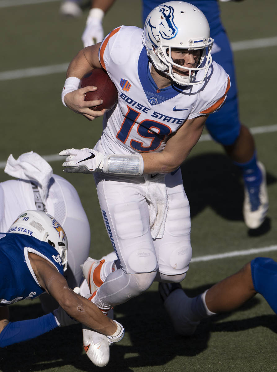 Boise State quarterback Hank Bachmeier (19) scrambles in the first quarter of the Mountain West ...