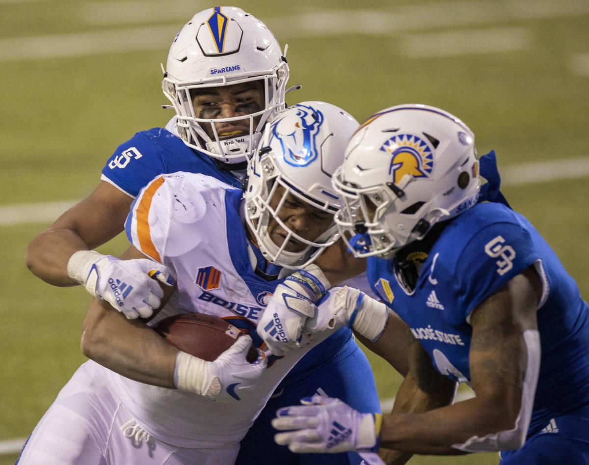 Boise State Broncos running back Andrew Van Buren (21) is tackled by San Jose State Spartans li ...