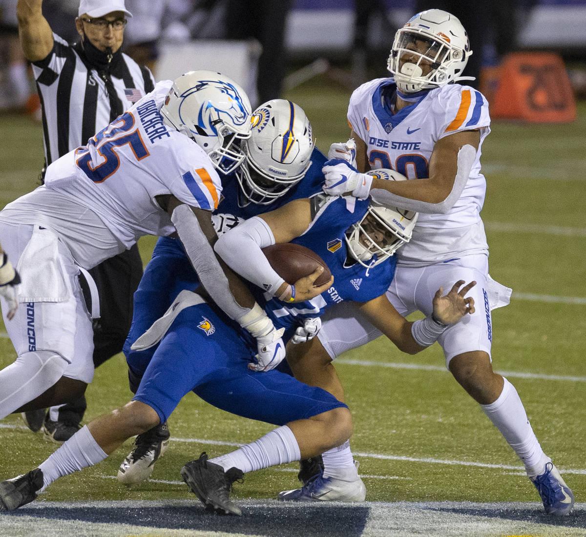 San Jose State Spartans quarterback Nick Starkel (17) is sacked by Boise State Broncos nose tac ...