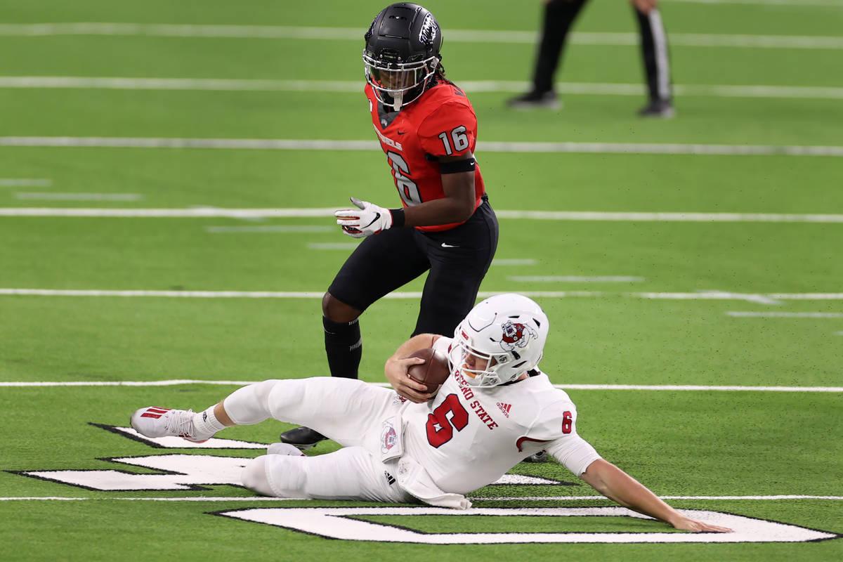 Fresno State Bulldogs quarterback Ben Wooldridge (6) slides for a gain of yards under pressure ...