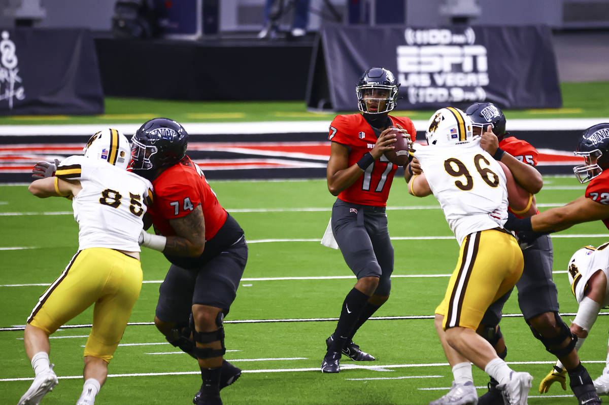 UNLV Rebels quarterback Doug Brumfield (17) looks to throw a pass against the Wyoming Cowboys d ...