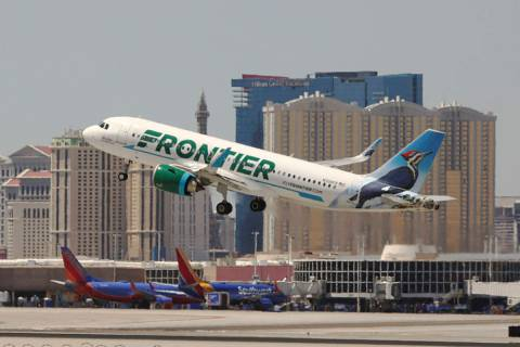 A Frontier Airlines flight departs McCarran International Airport in Las Vegas, June 26, 2019. ...