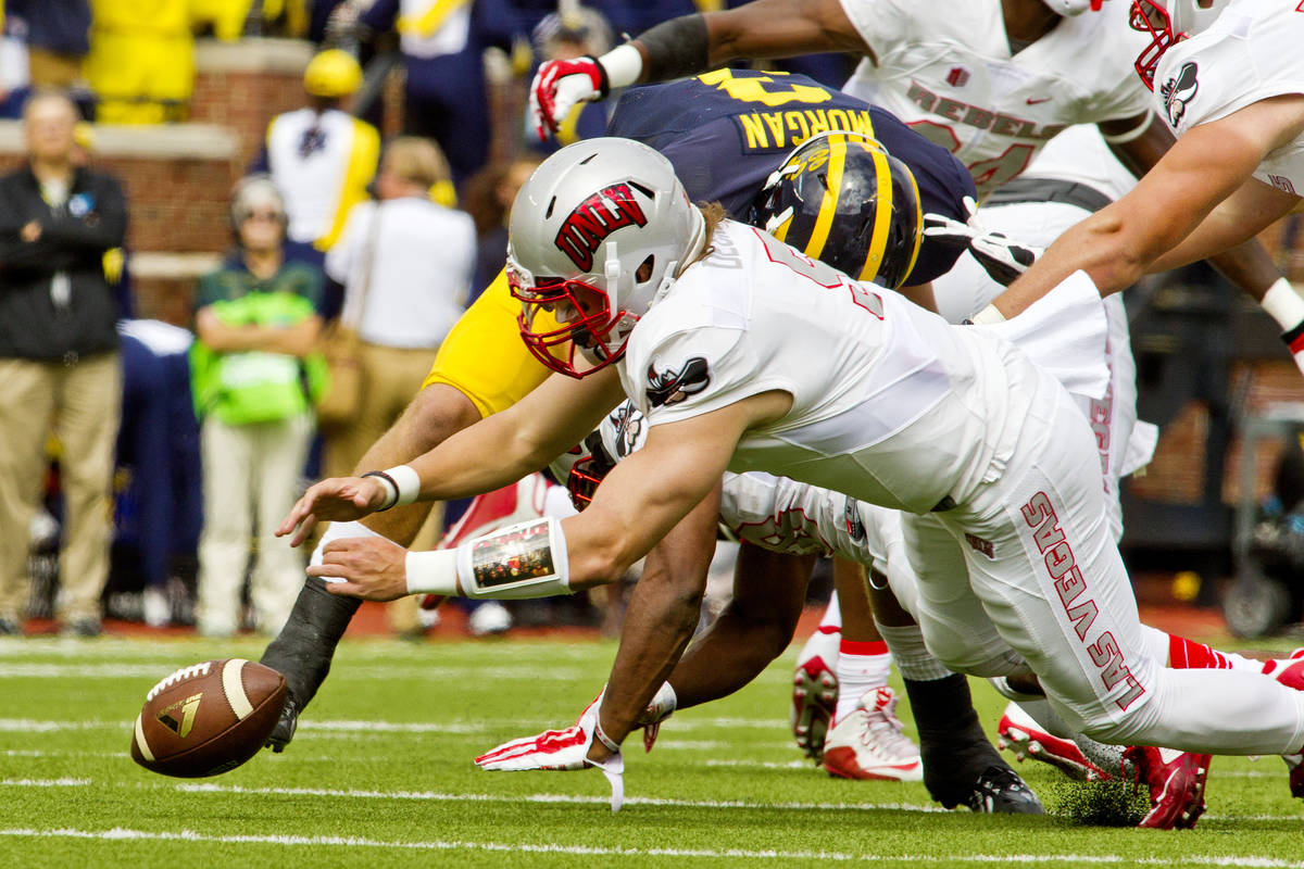 UNLV quarterback Blake Decker (5) recovers his own fumble in the first quarter of an NCAA colle ...