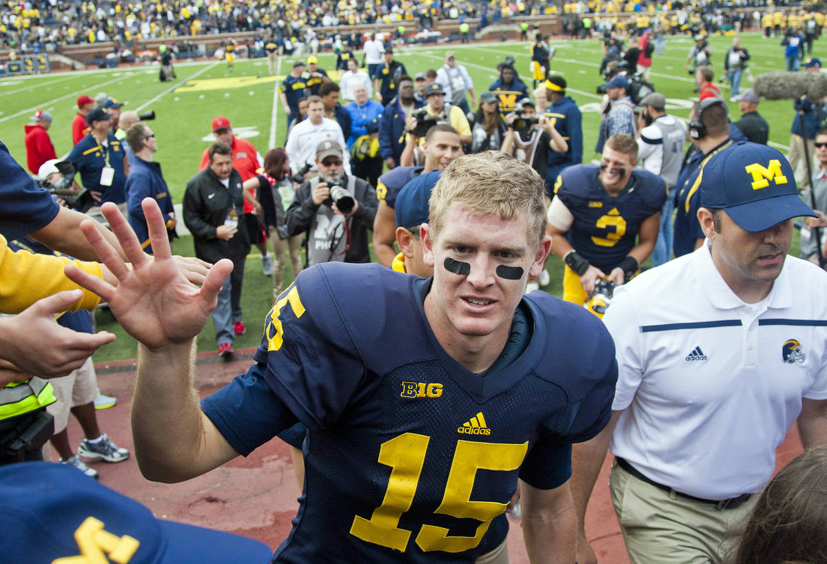 Michigan quarterback Jake Rudock (15) greets fans walking off the field after an NCAA college f ...