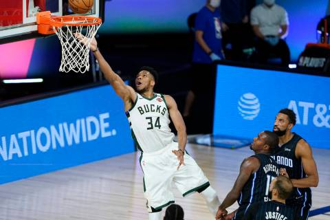 Milwaukee Bucks' Giannis Antetokounmpo (34) drives to the basket during the first half of an NB ...