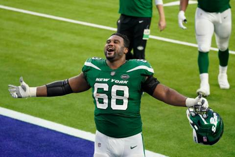 New York Jets offensive guard Josh Andrews (68) celebrates after a win over the Los Angeles Ram ...