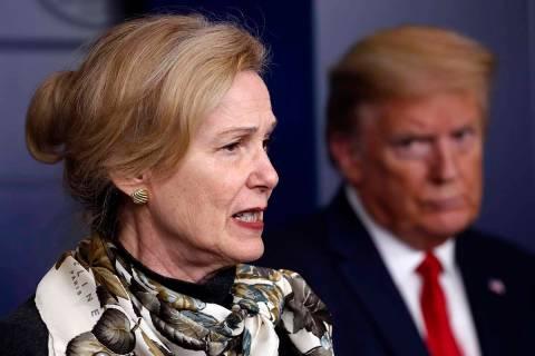 FILE - In this April 22, 2020, file photo, President Donald Trump listens as Dr. Deborah Birx, ...