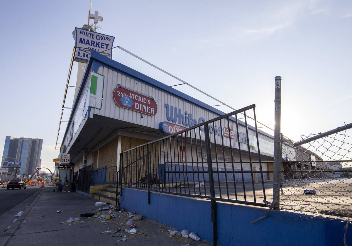 Trash is littered in front of the building where now-closed businesses Vickie's Diner and White ...