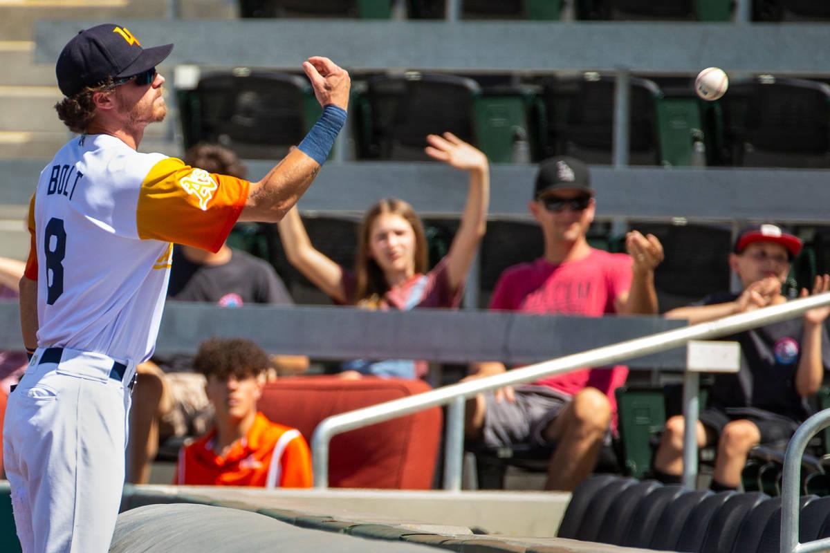 Las Vegas Aviators right fielder Skye Bolt (8) tosses a foul ball to a fan in the fourth inning ...