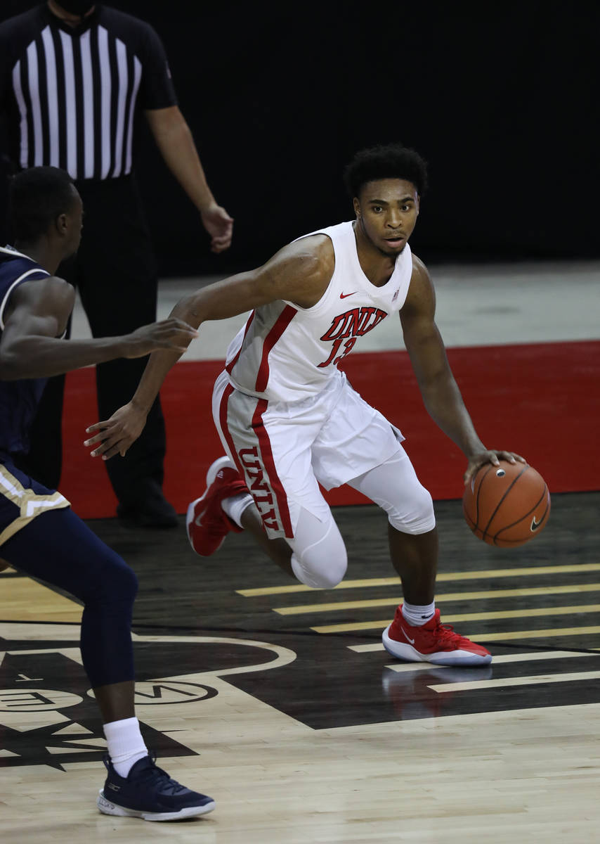 UNLV Rebels guard Bryce Hamilton (13) dribbles the ball against Montana State Bobcats during th ...