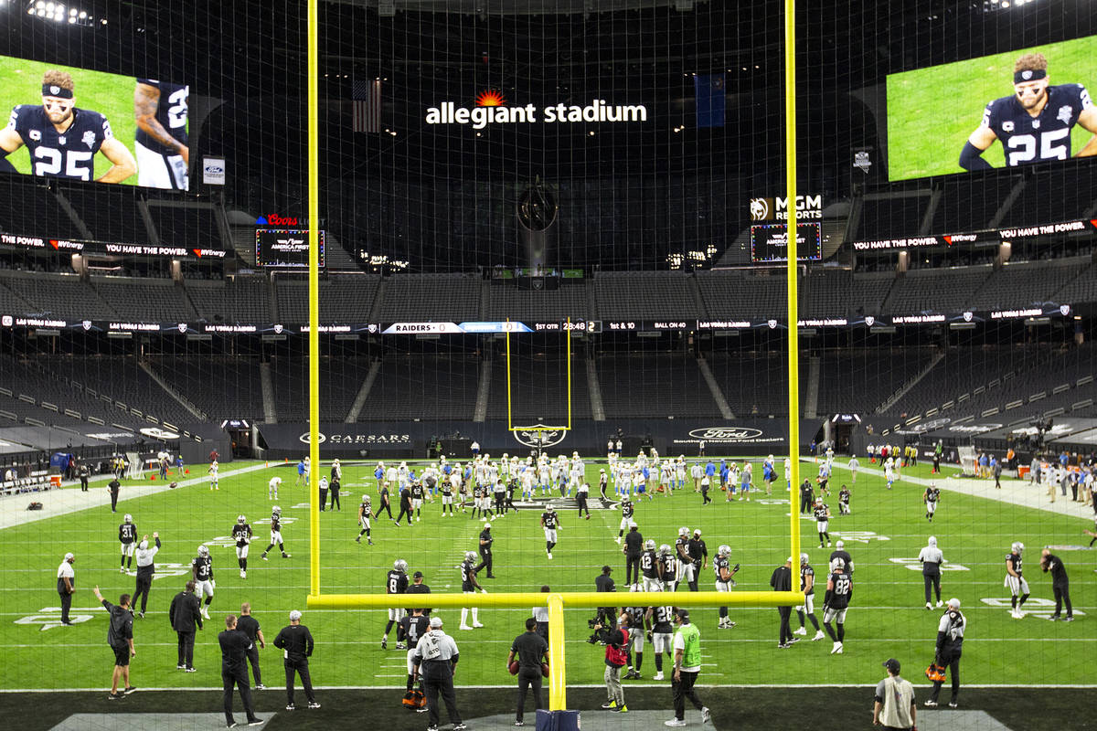 The Raiders and the Chargers warm up in a stadium empty of fans due to the coronavirus pandemic ...