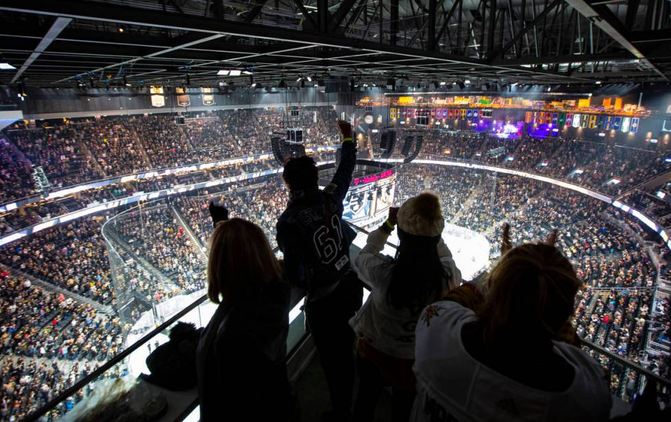 Golden Knights fans cheer from the Hyde Lounge space at T-Mobile Arena at the start of an NHL h ...