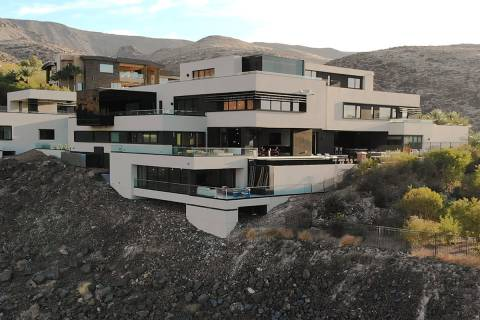 This 14,486-square-foot mansion in MacDonald Highlands in Henderson has sold for $11,250,001. T ...
